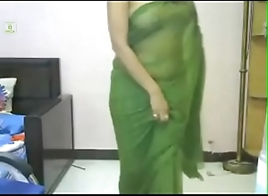 Desi girl with still wet behind the ears sari. looking smokin' hot with indian song. Must watch.