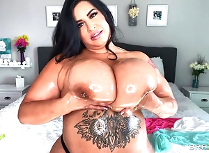 Sexy BBW oils their way immense boobs plus plays with them